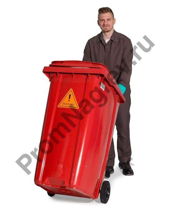 Перевозка аварийного набора в красном контейнере на колёсиках.